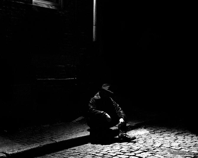 Fedora Man Sitting on the Curb by Matt Brittenham-Jones