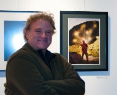 "Gordon Miller posing in front of ""Earth Man"" at the After Dark Reception"